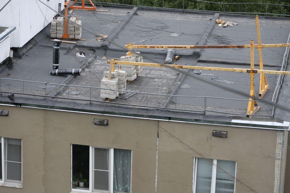 Крепление люльки на крыше здания